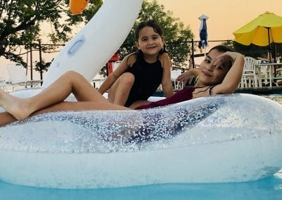 little-girl-on-swan-pool-float
